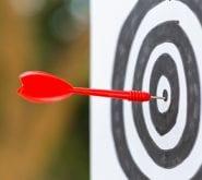 Dart in Bulls-eye of Target