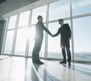 Businessmen Standing Shaking Hands