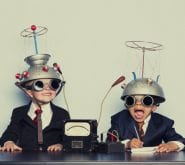 Boys Dressed as Businessmen Wearing Mind Reading Helmets