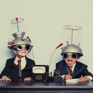 Boys Dressed as Businessmen Wearing Mind Reading Helmets